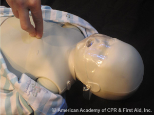 Chest compression using two finger technique on infant